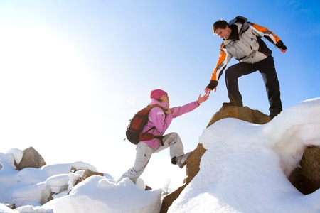 ascend: Two climbers ascend the mountain Stock Photo