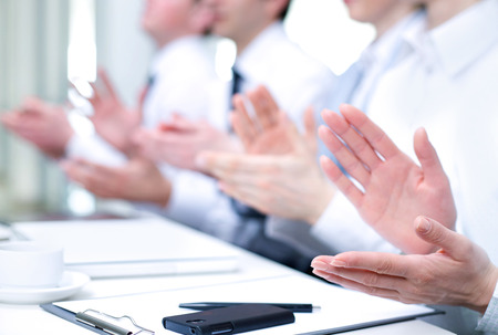 ovation: Photo of business partners hands applauding at meeting
