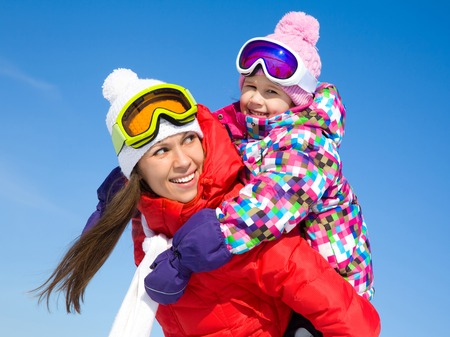 Portrait of smiling woman with cute little girl in wintertime photo
