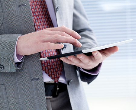 unrecognizable people: Unrecognizable business man holding a digital tablet