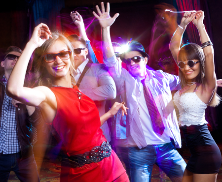 dance bar: Group of young people having fun dancing at  party. Stock Photo