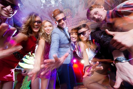 party night: Group of young people having fun dancing at  party. Stock Photo