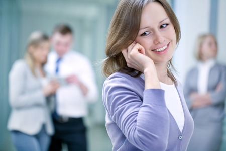 young business woman speaking by phone on business team background photo