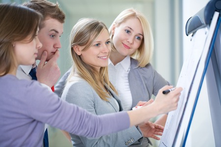 Contemporary business people working in team in the office Stockfoto