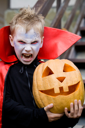 8   9 years: little boy curve faces in fairy costume on holiday halloween Stock Photo