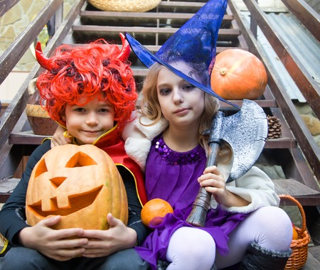 6 7 years: children in halloween costumes with pumpkin fooled on holiday Stock Photo
