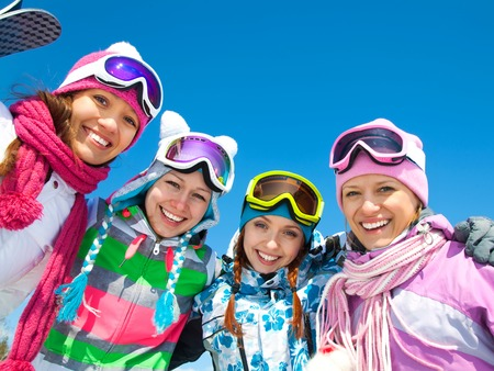 skiing: Group of young woman on ski holiday in mountains Stock Photo