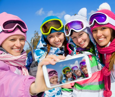 winter group of young woman  salfy in ski resort Archivio Fotografico