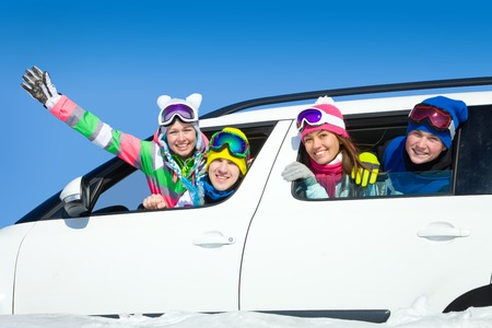 winter woman: young friends   go to winter vacations in car