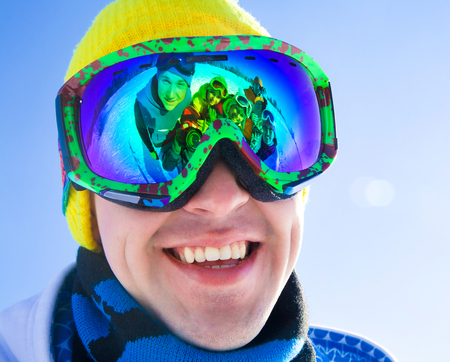 ski mask: Portrait of a young man in a ski mask with reflection group of friends