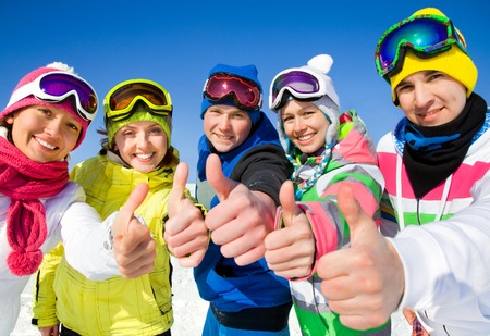 Group of young people on ski holiday in mountains Stock Photo - 36626045
