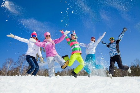 snowball: group of friends have a good time in winter resort Stock Photo