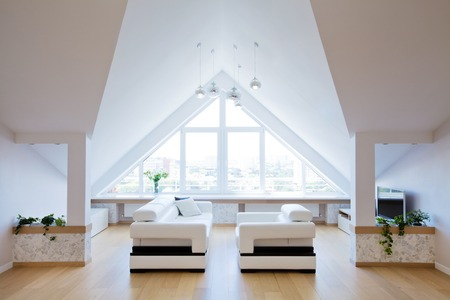 attic: modern interior light a large apartment in the attic Stock Photo