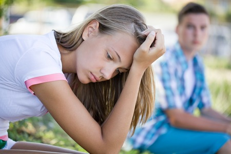 crisis of relations between teenagers Stock Photo