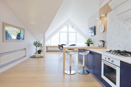 designer chair: modern interior light a large apartment in mansard