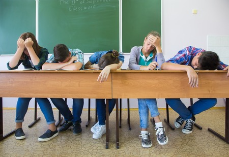 misses: group of students misses the lesson in the classroom
