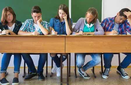 group of students takes the test in class Stock Photo