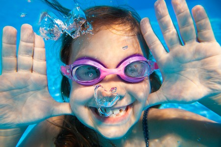 Funny underwater portrait of  cheerful girl