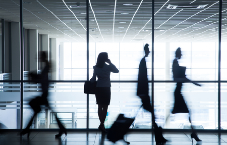 management team: Silhouette business people walking on the background of the large windows