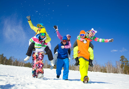 group of friends have a good time in winter resort Foto de archivo