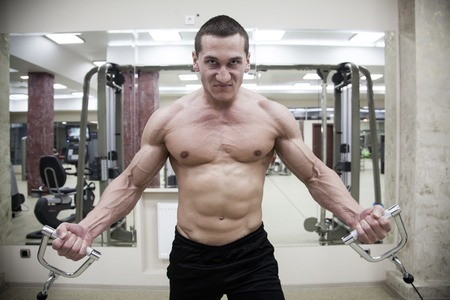 man gym: strong man is engaged in the gym Stock Photo