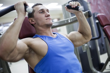 strong man is engaged in the gym photo