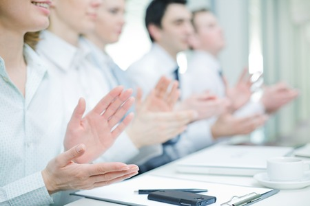 Photo of business partners hands applauding at meeting photo