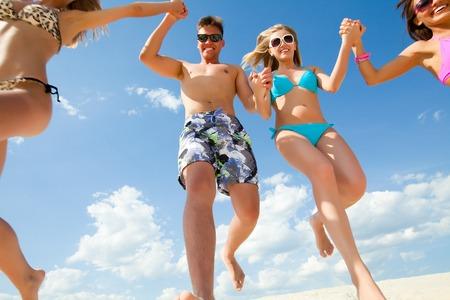 fun activity: Young fun people enjoying summer on the beach