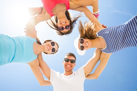 Young fun people are having good time on the beach photo