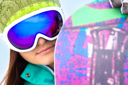 portrait of female snowboarder in glasses