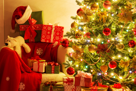 festively decorated  Christmas tree with gifts