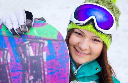 portrait of girl snowboarder in glasses