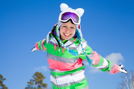 recreational: portrait of young smilling woman  on winter holiday outdoor