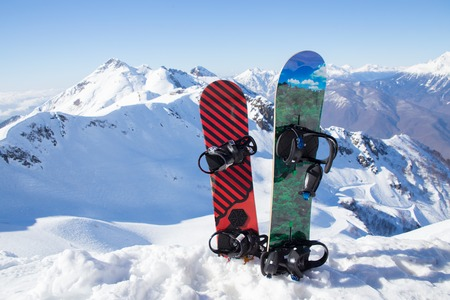 Two snowboard standing in the snow against the backdrop of the beautiful snow-capped mountains Stock Photo