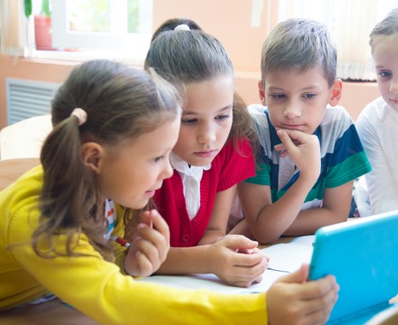 children  from elementary school together decide to learn from tablet