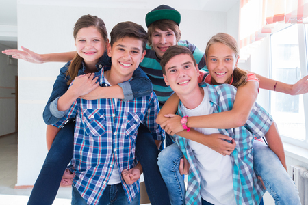 group of teenagers have a good time in the hallway Stock Photo