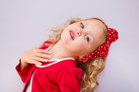 portrait of a little cute girl fashionista