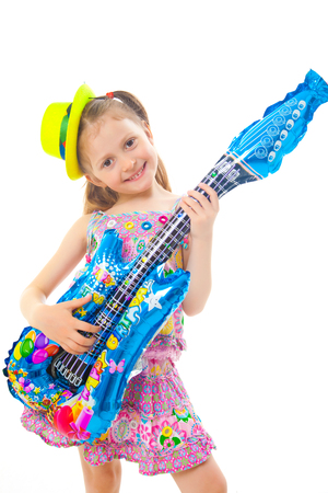 Portrait of cute little girl at party with guitar