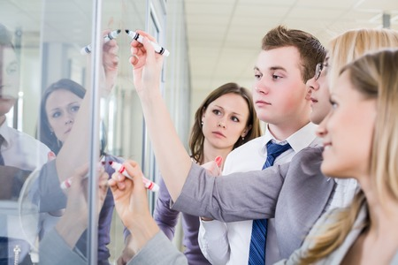 expertise: Contemporary business people working in team in the office Stock Photo