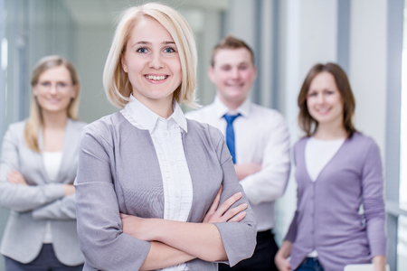 Successful businesswoman with colleagues in the background photo