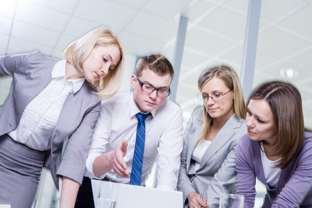 Contemporary business people working in team in the office photo