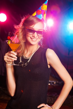 1 person: glamor portrait of a young girl with a cocktail in nightclub