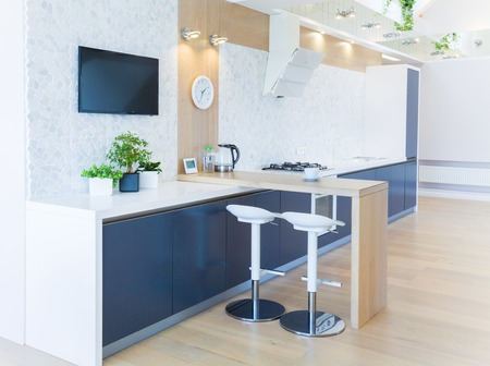 wood floor: modern interior  kitchen in large apartment in mansard Stock Photo