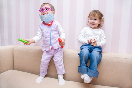 auscultate: Little girls  plays at doctor Stock Photo