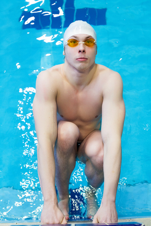 1 person: Young manl competitive swimmer in swimming pool Stock Photo