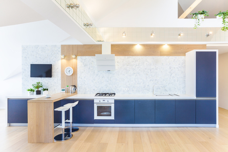 white wood floor: modern interior  kitchen in large apartment in mansard Stock Photo