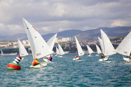 Regatta of sailing yachts on the sea on a windy day Archivio Fotografico