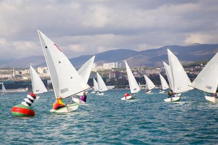 Regatta of sailing yachts on the sea on a windy day Standard-Bild