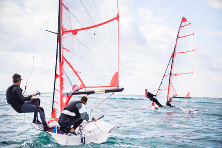 sailing crew: Regatta of sailing yachts on the sea on a windy day Stock Photo