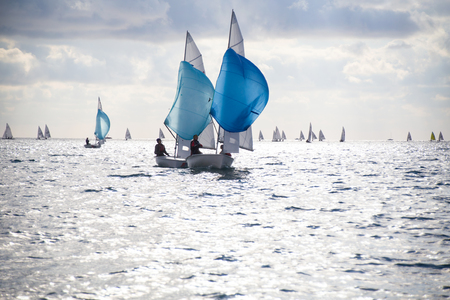Regatta of sailing yachts on the sea on a windy day Stock Photo